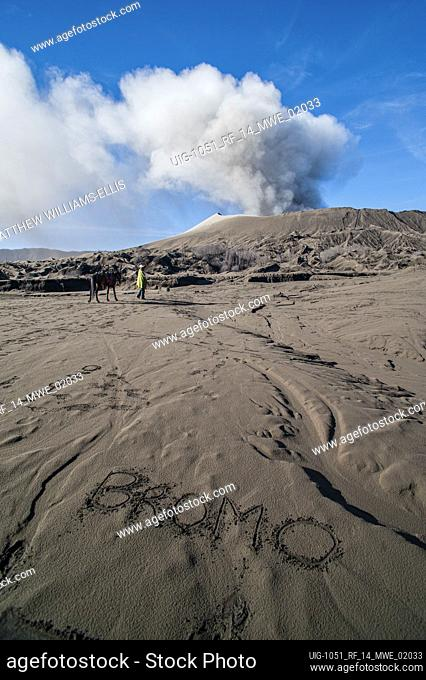 The Word Bromo Written in Ash at Mount Bromo, Bromo Tengger Semeru National Park, East Java Indonesia. As the ash fell from an erupting Mount Bromo