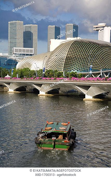 Bum boat in the Singapore River headed towards Esplanade, nicknamed 'the big durian,' and the Esplanade Bridge, Singapore