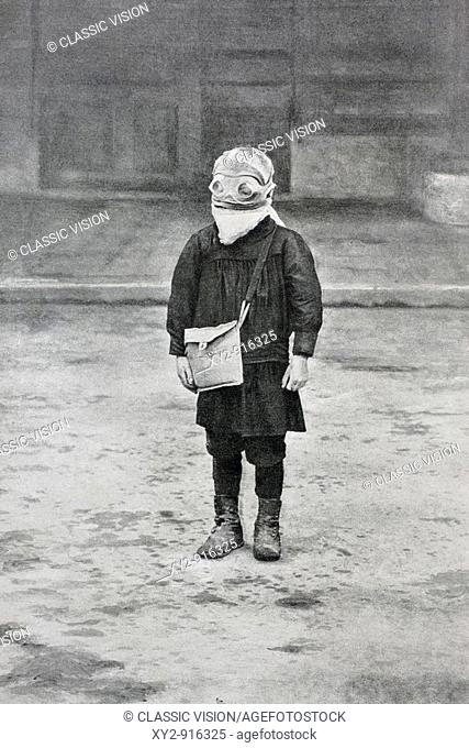 A schoolchild in Reims, France, wearing goggles and mask against asphyxiation shells  From L'Illustration, 1916