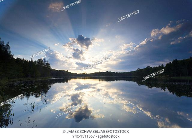 Sunset over Twin Pond in the Adirondack Mountains in Old Forge New York