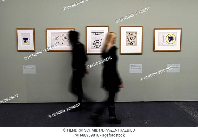 Two women look dish designs by Wassily Kandinsky (1920/21) during a preview at the art museum Moritzburg in Halle/Saale, Germany, 8 March 2017