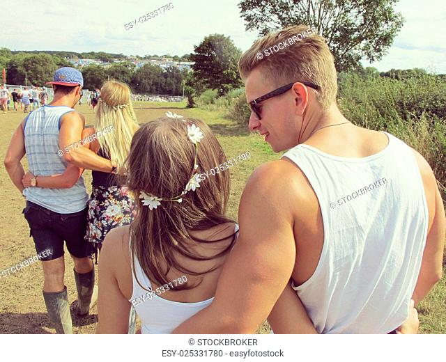 Group Of Friends Walking To Music Festival