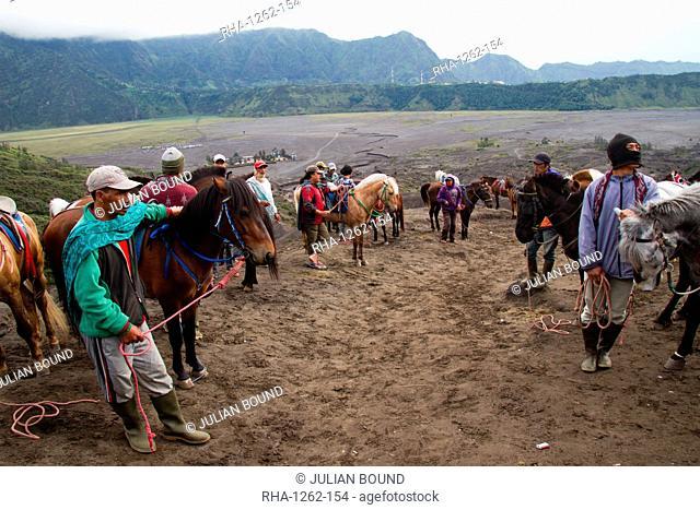 Horsemen on Mount Bromo volcano, Eastern Java, Indonesia, Southeast Asia, Asia