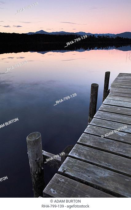 Early morning on a jetty at Lake Mahinapua, West Coast, South Island, New Zealand, Pacific