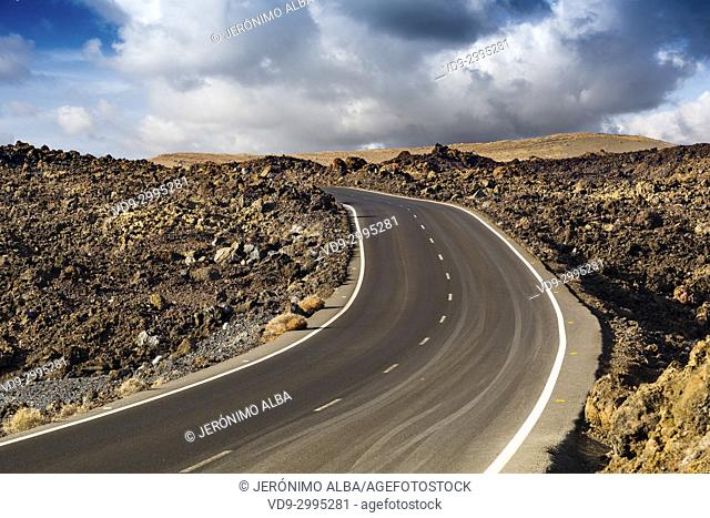 Road through volcanic landscape. Lanzarote Island. Canary Islands Spain. Europe