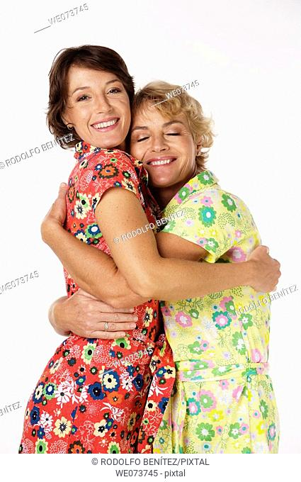 Mother and daughter hug in a studio setting