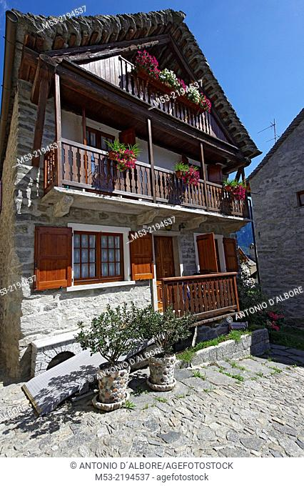 A traditional alpine home made of stone and wood in Viceno di Crodo, a small village in Verbano-Cusio-Ossola Province. Piedmont. Italy