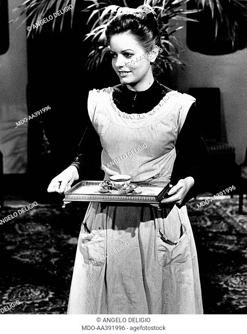 Nada in Puccini. Italian singer Nada (Nada Malanima) holding a tray in the TV mini-series Puccini. She plays the housemaid Doria Manfredi. Milan, 1973