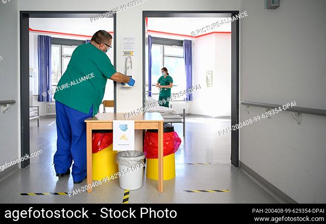 06 April 2020, Baden-Wuerttemberg, Künzelsau: Employees of the German Red Cross prepare rooms in an isolation ward in a former clinic