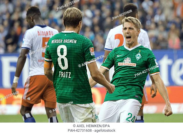 Bremen's Nils Petersen (L) celebrates the 0-1 goal with team-mate Clemens Fritz during the Bundesliga soccer match between Hamburger SV and Werder Bremen at...