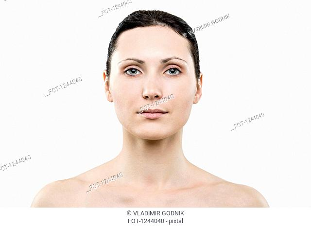 Portrait of beautiful woman looking at camera
