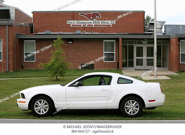 Ford Mustang in front of the New Simpsons Hill School, Home of the Mustangs, Illinois, USA