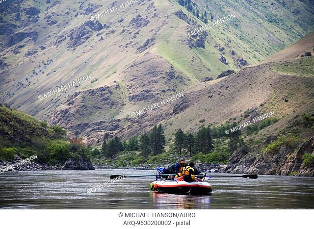 Two boaters float down the Snake River in Oregon on an oar rig