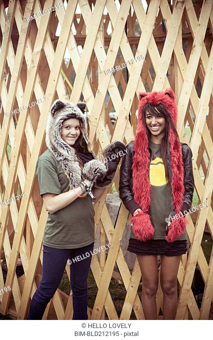 Women wearing furry hats outdoors
