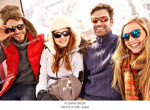 Friends smiling together on ski lift