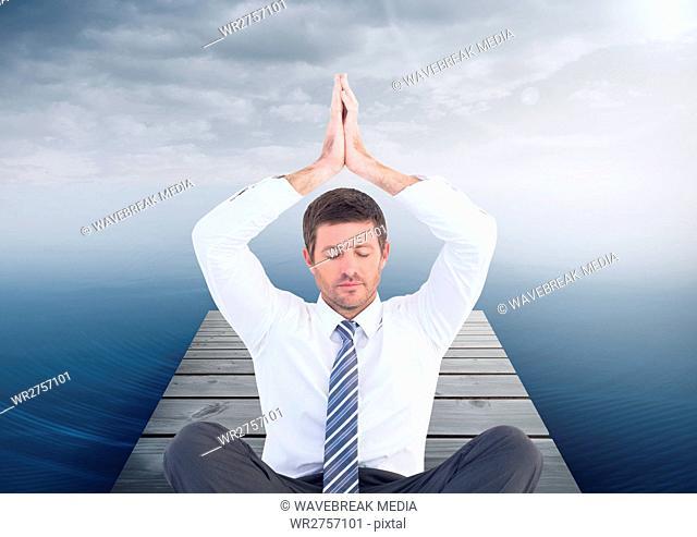 Man Meditating by sea