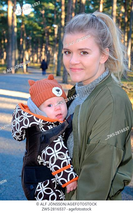 Young mother with baby in a forest in Ystad, Sweden