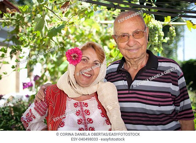 Romanian elder couple, the woman dressed in Romanian traditional folk costume