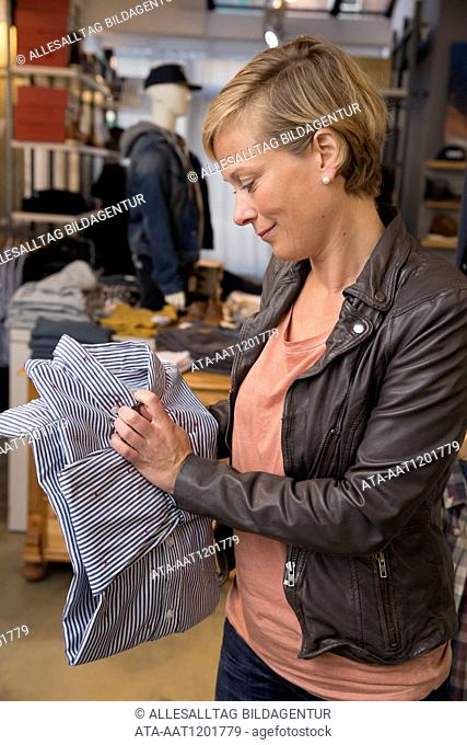 Woman is buying menswear