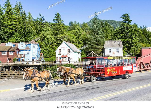 Horse-Drawn Trolley Tour Travels Along The Famous Creek Street In Downtown Ketchikan In Southeast, Alaska During Summer