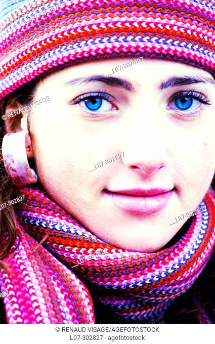 Teenager in striped hat and scarf smiling
