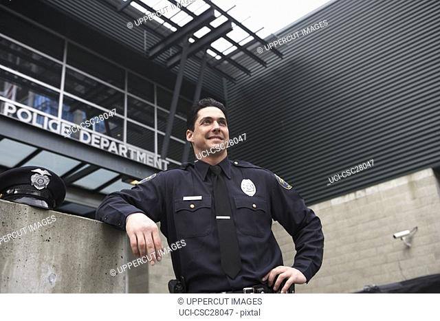 Male police officer resting outside Police Department