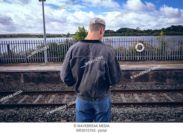 Rear view of man standing on platform