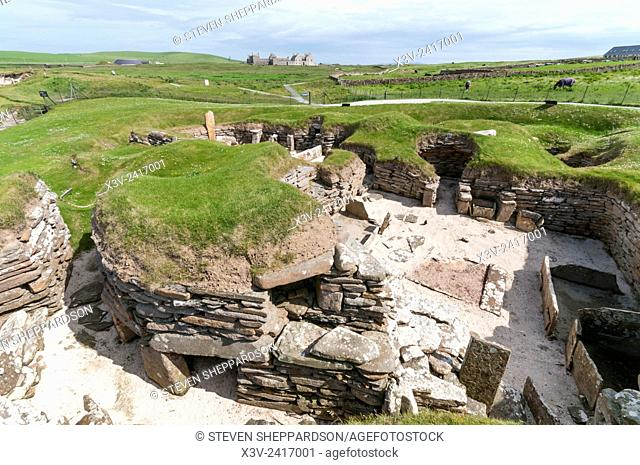 Europe, UK, Scotland, Orkney - Skara Brae Neolithic village with Skaill House in the background