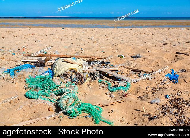 Discarded trash on the beach near red sea in Egypt