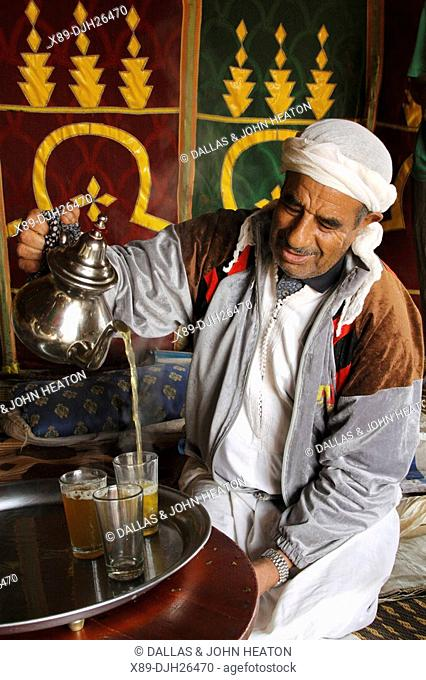 Africa, North Africa, Morocco, Meknes, Decorated Berber Tent, Man Pouring Tea