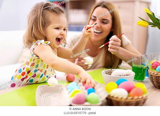 Happy time while painting easter eggs. Debica, Poland