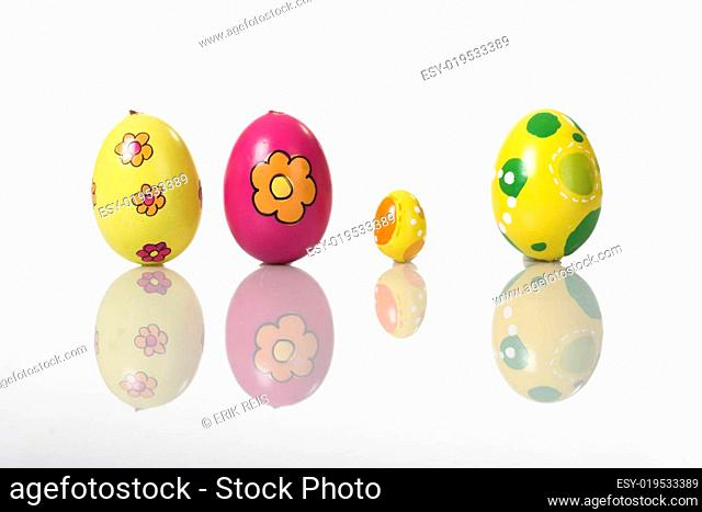 Colored Easter eggs isolated on white with reflection
