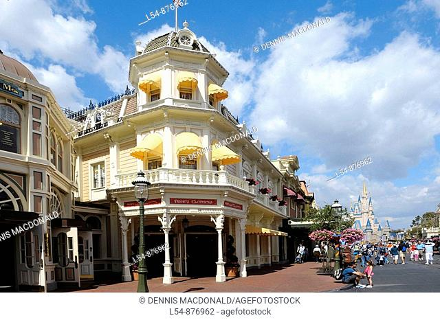 Store with yellow awnings along Main Street at Walt Disney Magic Kingdom Theme Park Orlando Florida Central