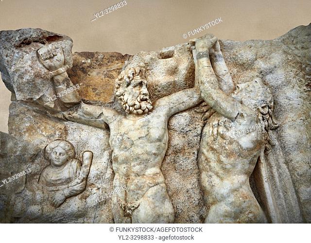 Close up of a Roman Sebasteion relief sculpture of Zeus and Prometheus, Aphrodisias Museum, Aphrodisias, Turkey. Against an art background.