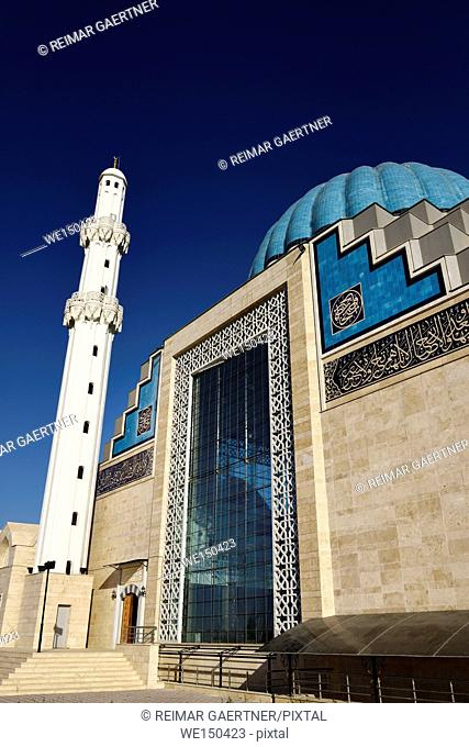 White minaret and ribbed dome of modern Hoca Ahmet Yesevi Mosque in Turkistan Kazakhstan