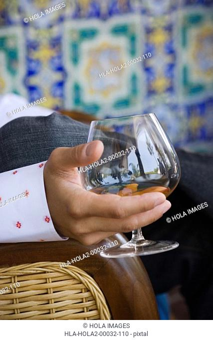 Close up of man holding glass of alcohol