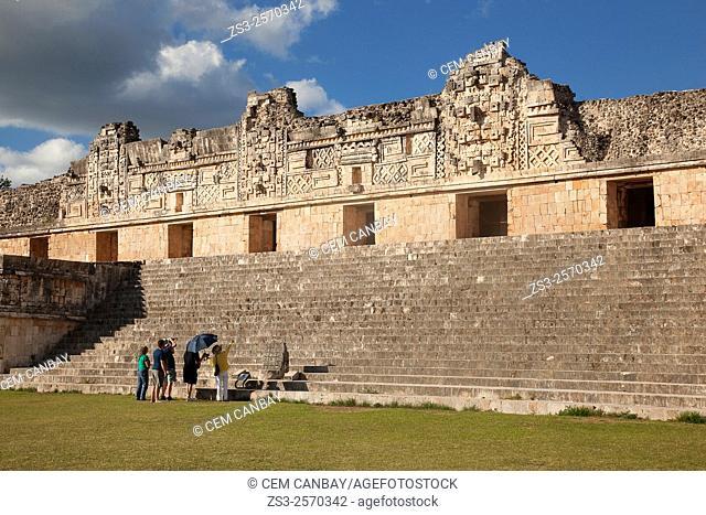 Tourists in Uxmal Ruins near the Quadrangle Of The Nuns, Yucatan Province, Mexico, Central America