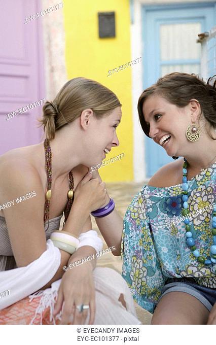 Two cheerful young women having fun