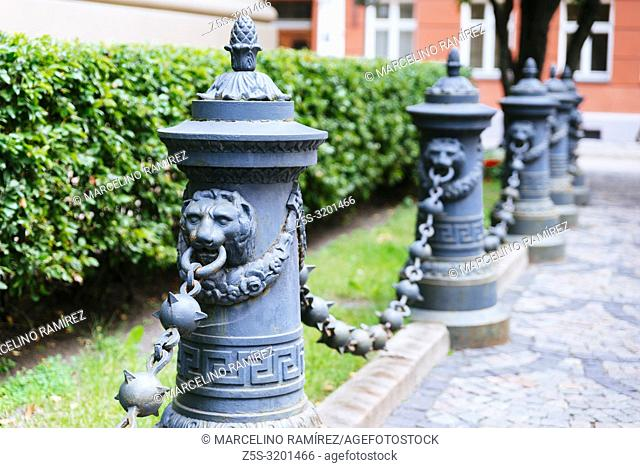 Bollards with lions heads and chains in the old town. Riga, Latvia, Baltic states, Europe