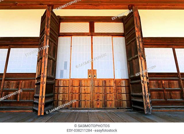 The traditional wooden sliding door with paper (called fusuma) at Hokke-ji Temple, in Takayama, Gifu, Japan