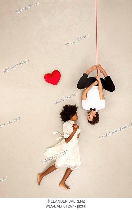 Couple falling in love, man hanging upside down