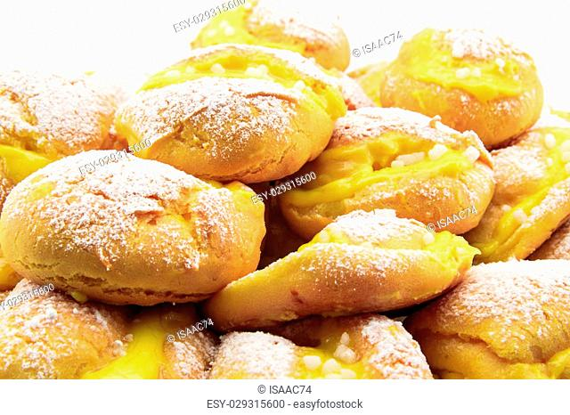 handmade cream puffs with icing sugar