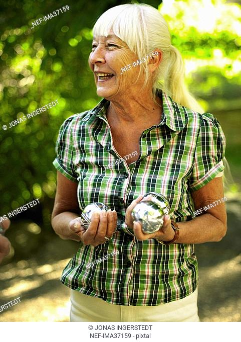 Woman playing boule