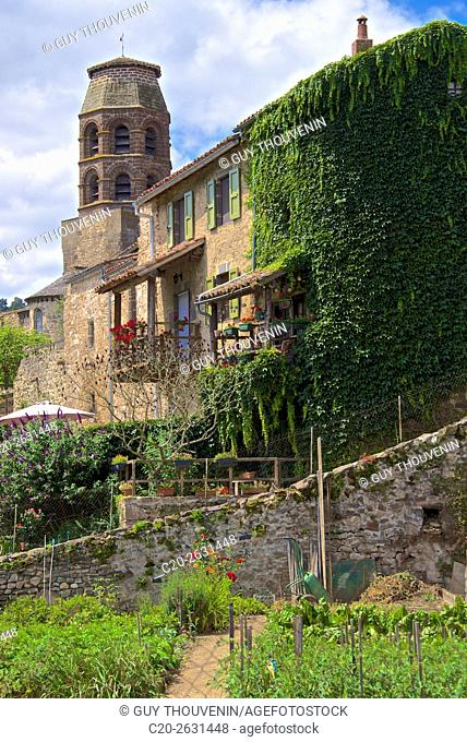 Village walls, tower of benedictine roman abbey, and kitchen garden in the foreground, Lavaudieu, medieval village, 43, Auvergne, Haute Loire, France