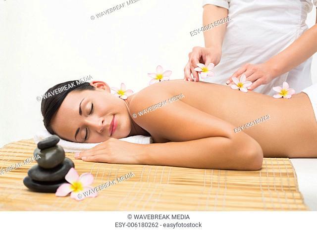 Beautiful brunette enjoying a back massage