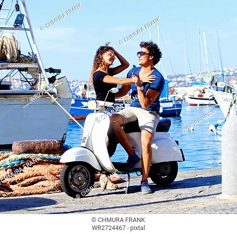 Young Italian Couple on Vespa Scooter Having Fun