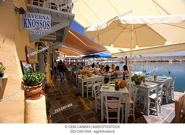 People at the restaurants in Rethymno harbor, Rethymno, Crete, Greek Islands, Greece, Europe