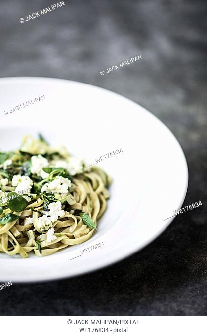 gourmet organic italian ricotta and fresh mixed herbs tagliatelle on plate