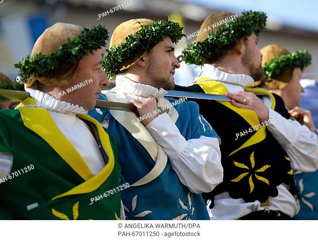 So-called Sword dancers in traditional costumes for the traditional 'Georgiritts' on Easter Monday in Traunstein, Germany, 28 March 2016