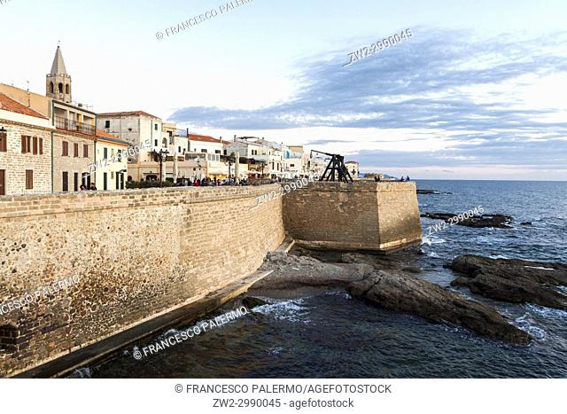 Scenic view of waterfront and an romantic sky during sunset. Alghero, Sardinia. Italy